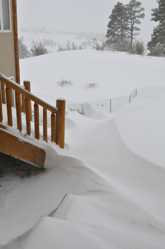 It's hard to tell, but the lawn is sloping away -- those drifts are at least 3' deep.